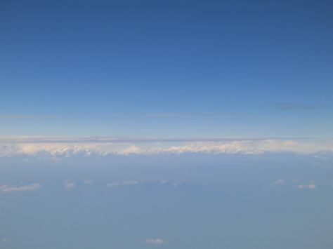 Himalaya view from the plane. It was even above the clouds!