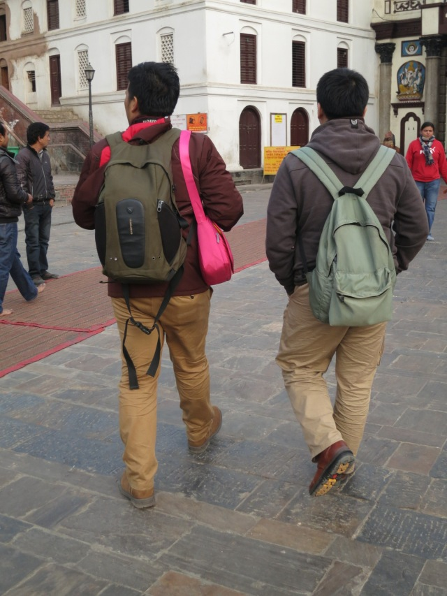 The twins rushing down Pasupathinath Temple.