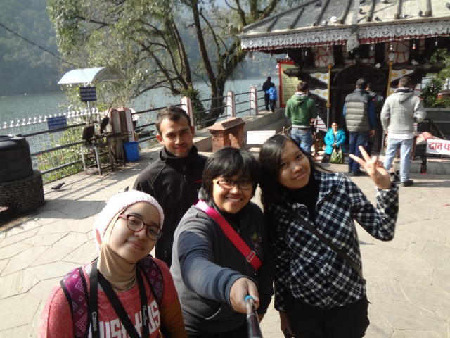 The girls were taking a picture with Kumar in the temple in Phewa Lake