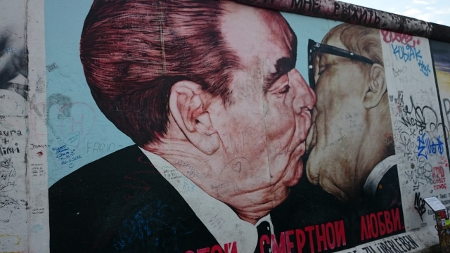 Love wins on wall of Berlin.